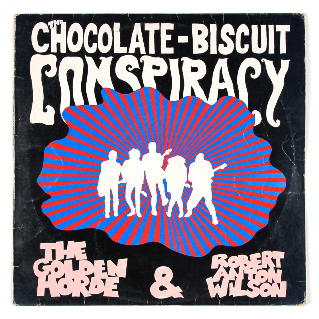 The Chocolate Biscuit Conspiracy; The Golden Horde and Robert Anton Wilson; Hotwire (1985); Design: Des O'Byrne / Photos: Conor Horgan, Debbie Schow